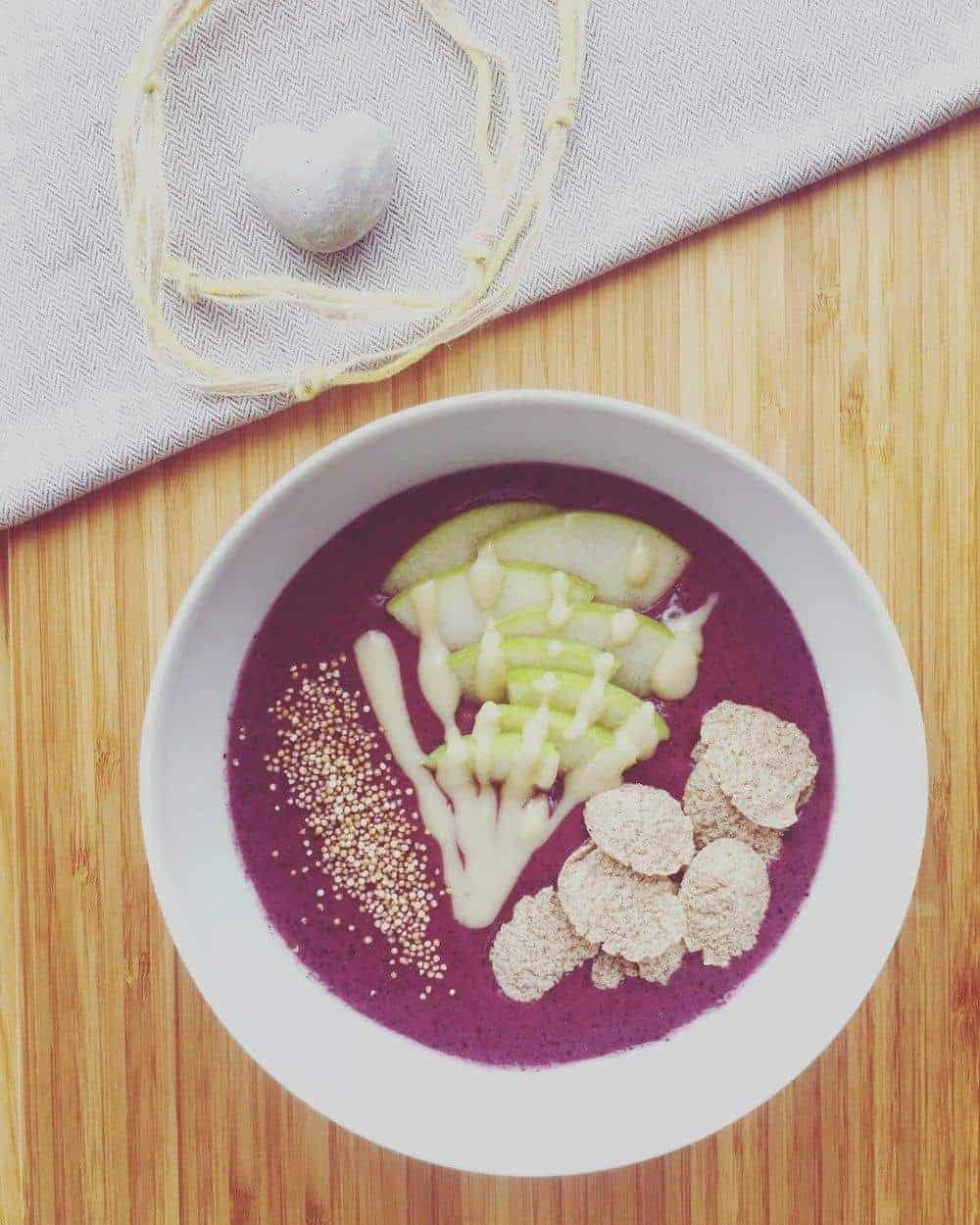 acai bowl topped with apple and popped amaranth