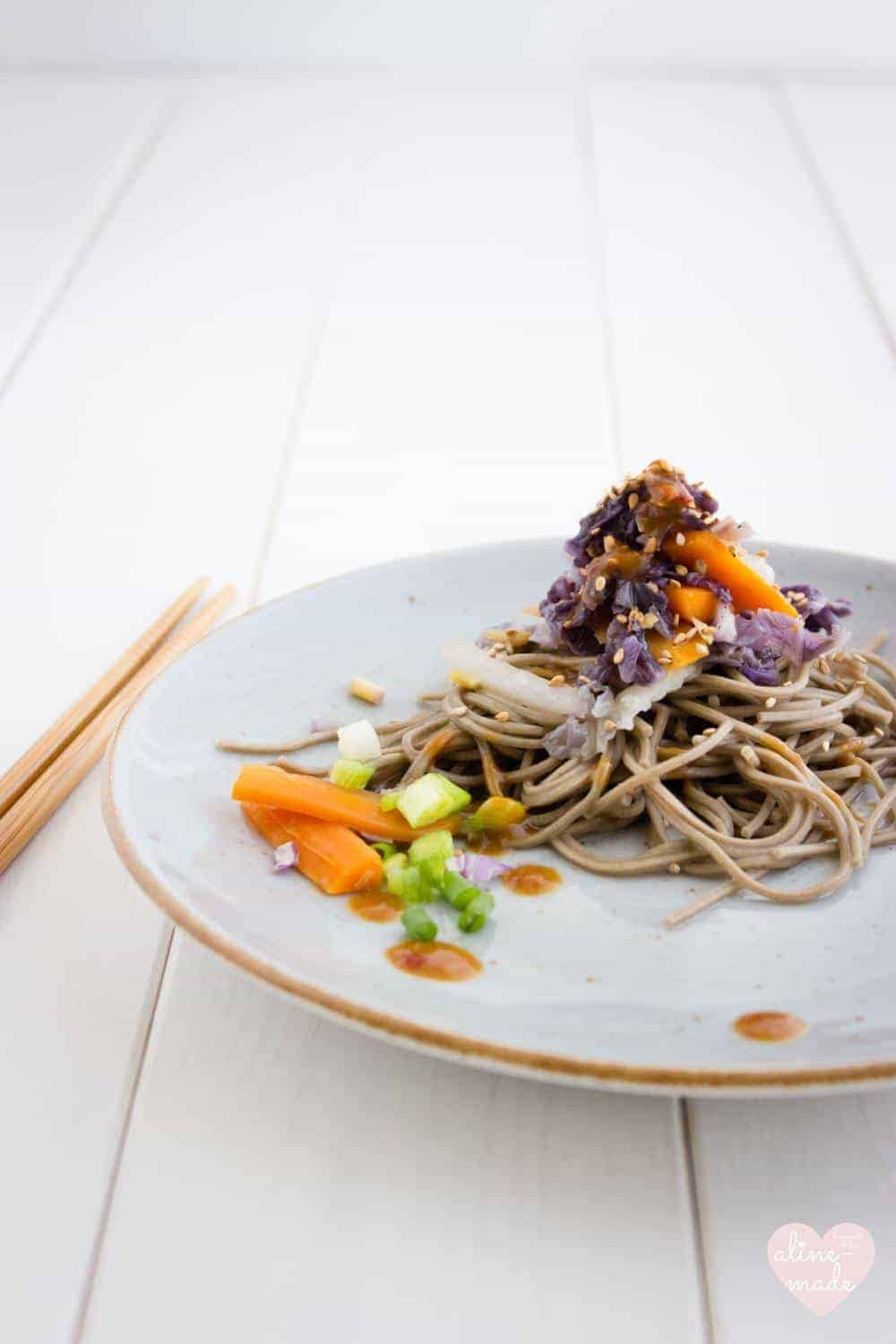 Veggie Soba Noodles with Miso Sauce served on a blue plate