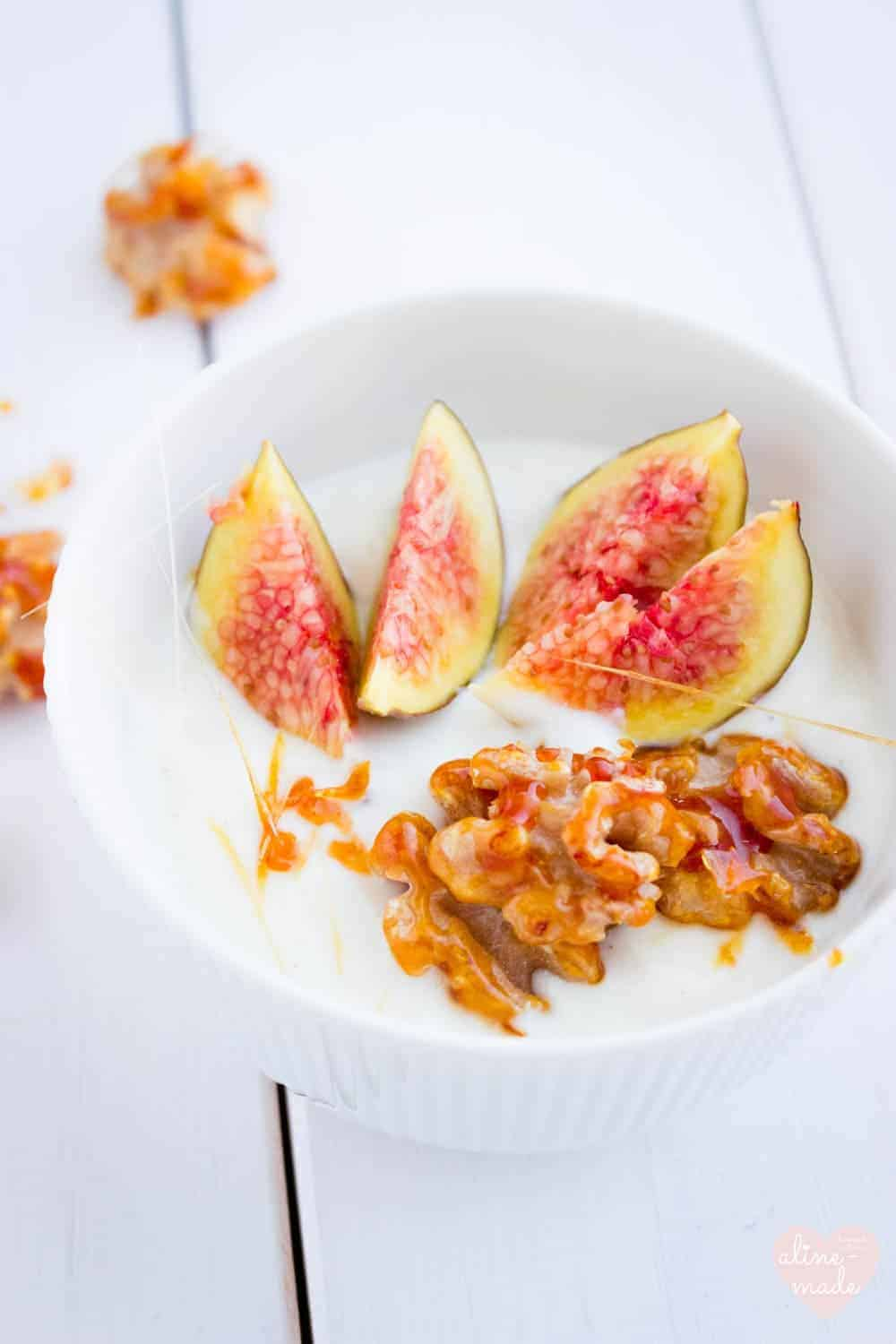 Yogurt in a bowl with figs and candied walnuts