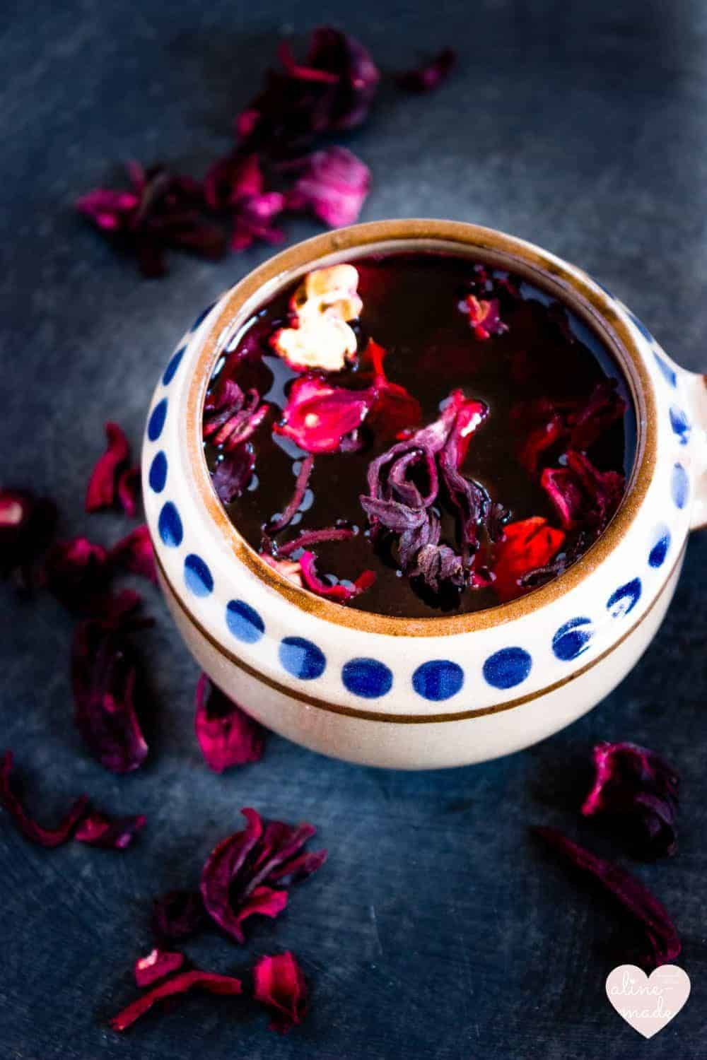 Agua de jamaica hibiscus iced tea aline made agua de jamaica served in a mexican pot and topped with dried hibiscus flowers izmirmasajfo