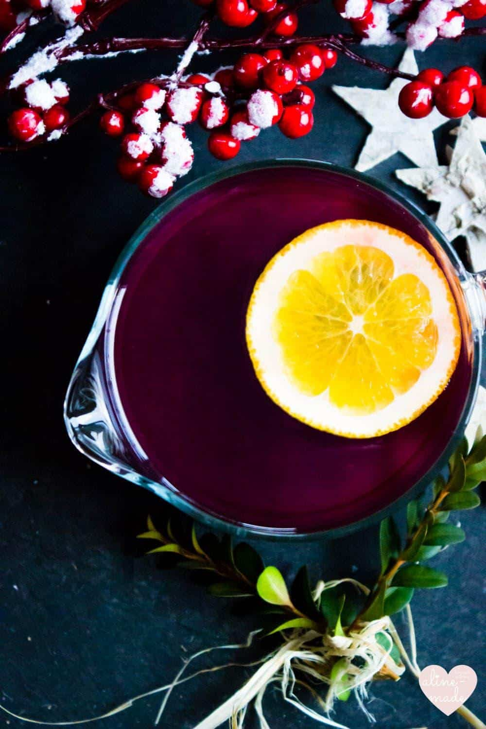 Ginger Mulled Wine served in a glass and topped with an orange slice