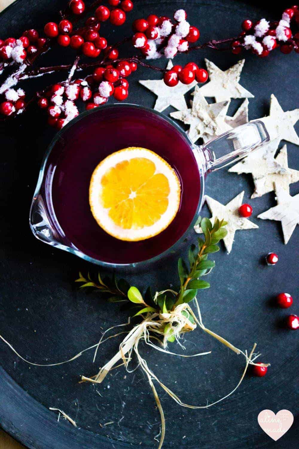 Ginger Mulled Wine Recipe topped with an orange slice and decorated with stars
