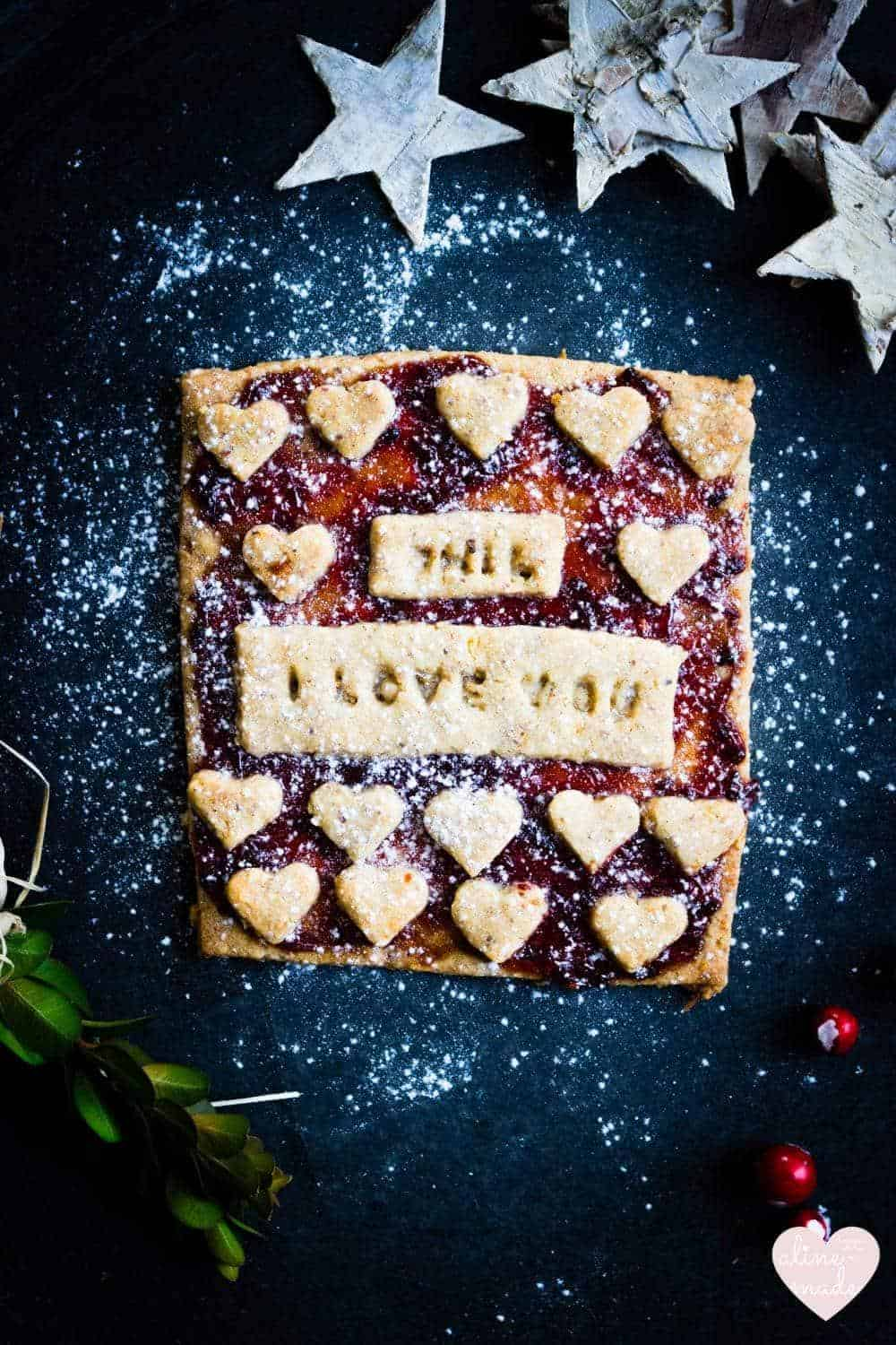 Linzer Christmas Cookies - Decorated with hearts and a love message!