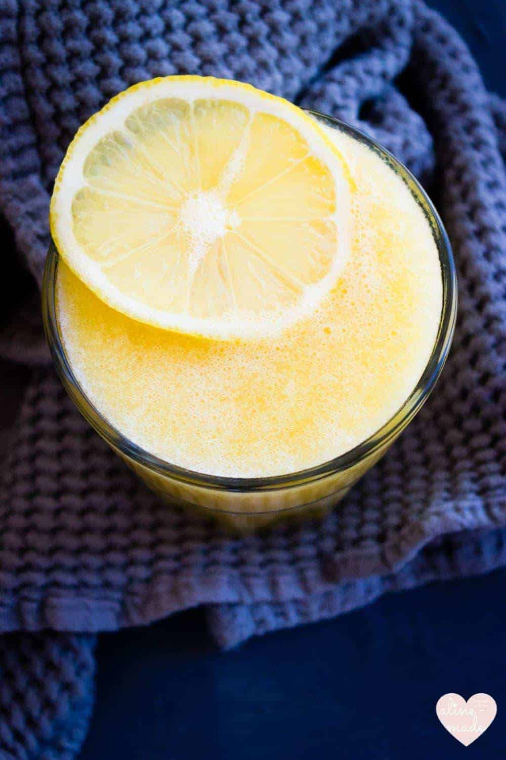 Simply Mango Lemonade - Sparkling yellow topped with a slice of lemon
