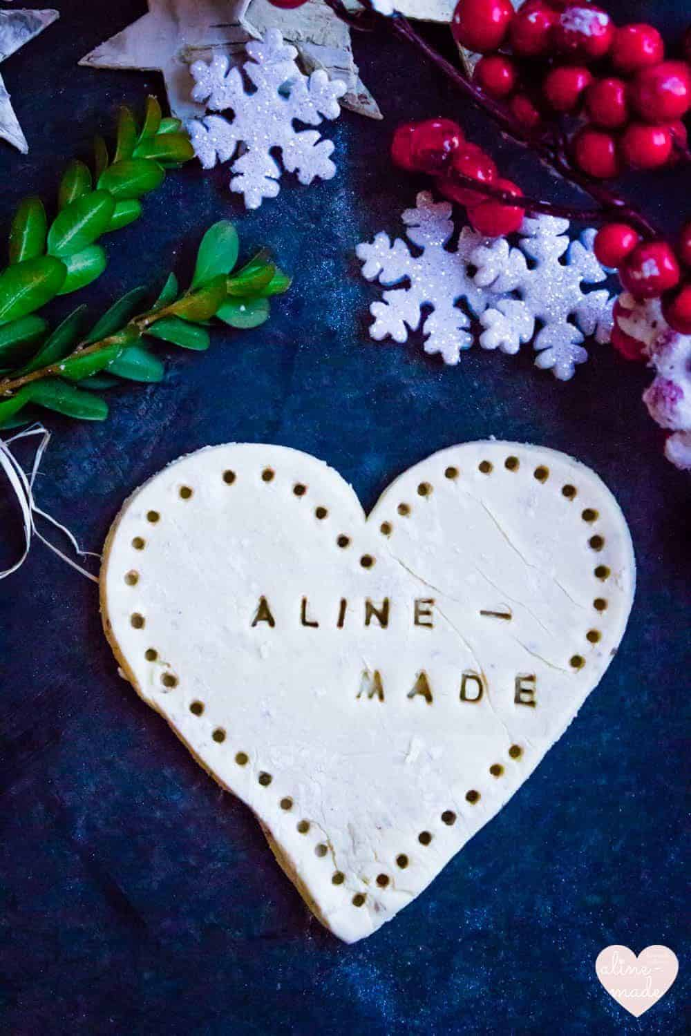 Swiss Anise Cookies in a heart shape with Aline Made decorated