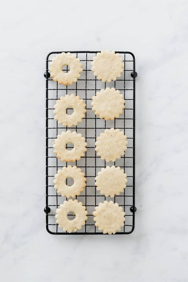 linzer cookie bottom and tops on a cooling wrack