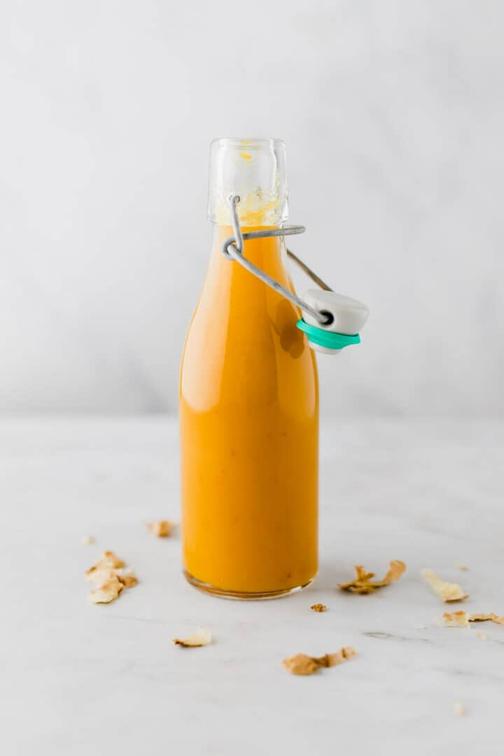 ginger turmeric shot in a glass bottle