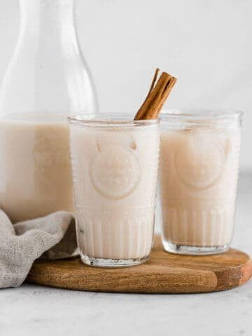 almond milk horchata in glasses on a board