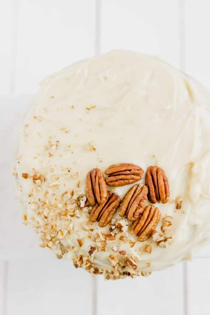 carrot cake with frosting and pecan nuts