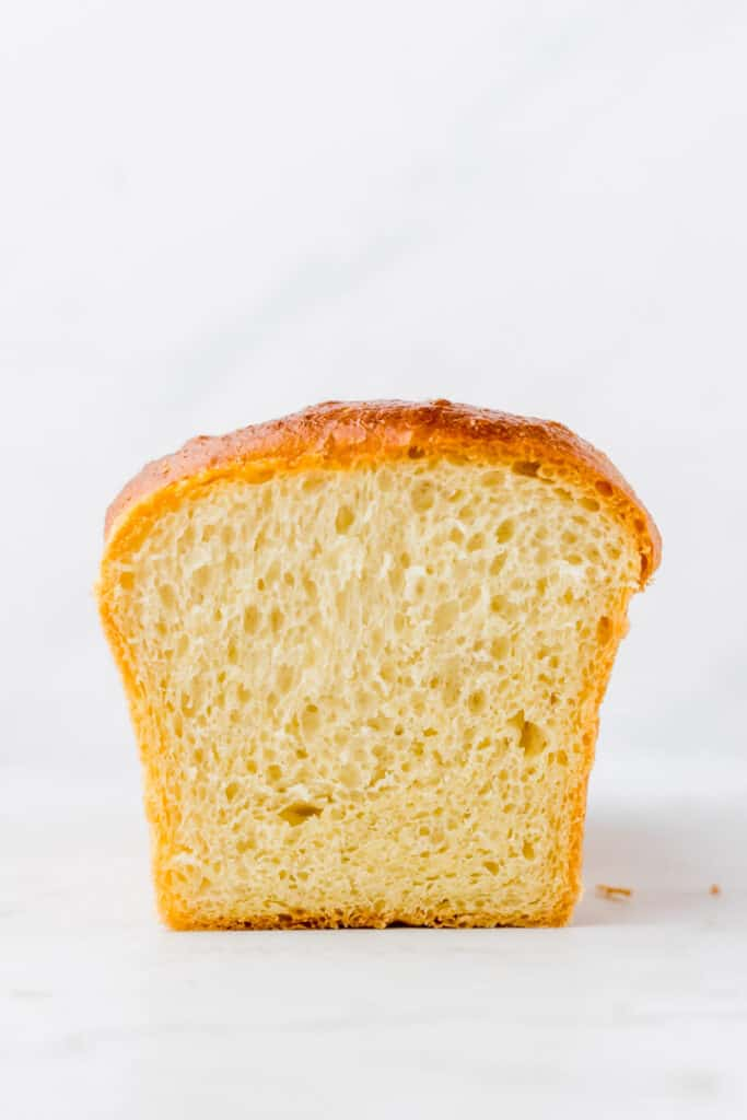 baked brioche loaf served on a white table