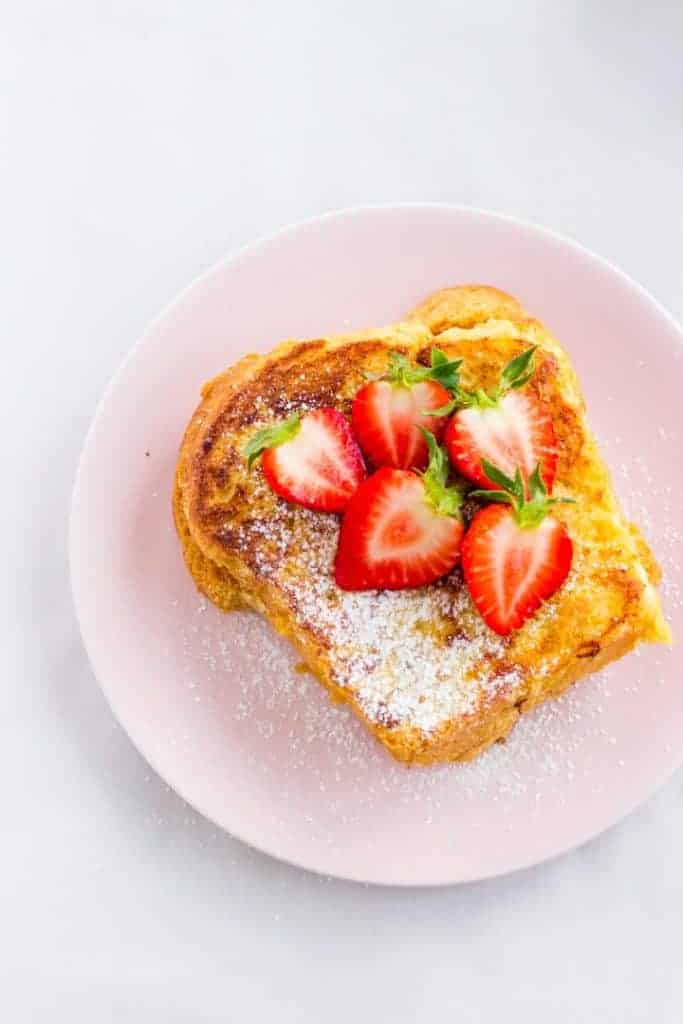 Brioche French Toast with strawberries and powdered sugar