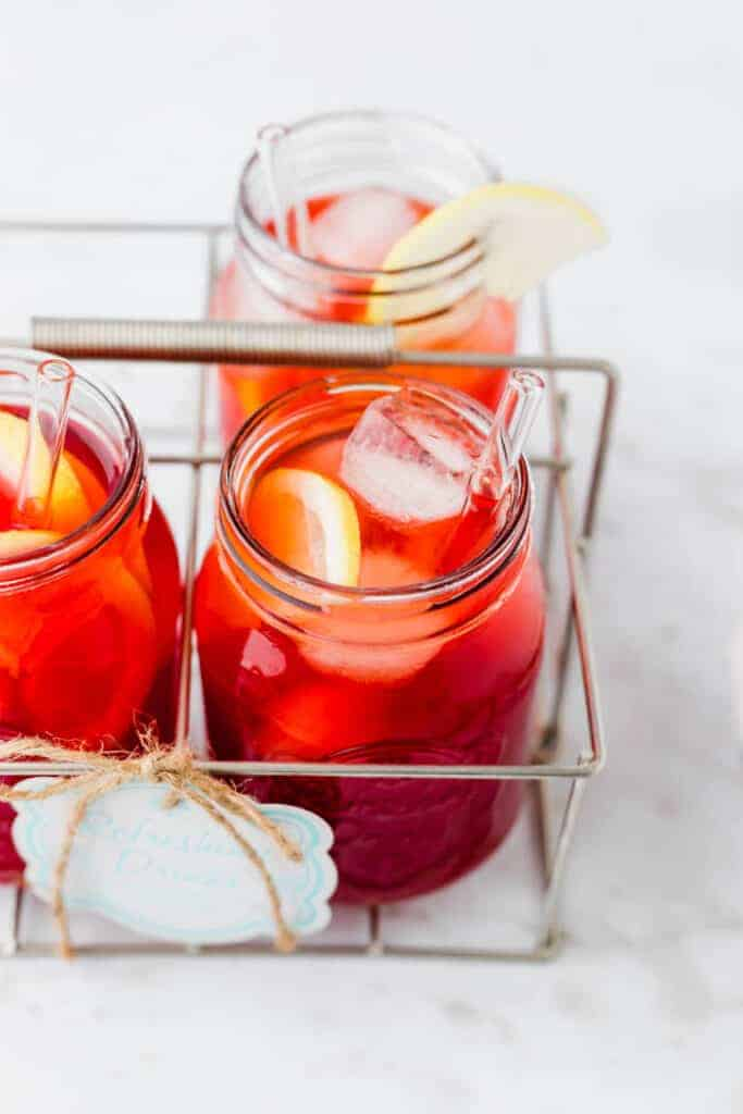 iced tea recipe served in summer glasses with ice and lemon slices