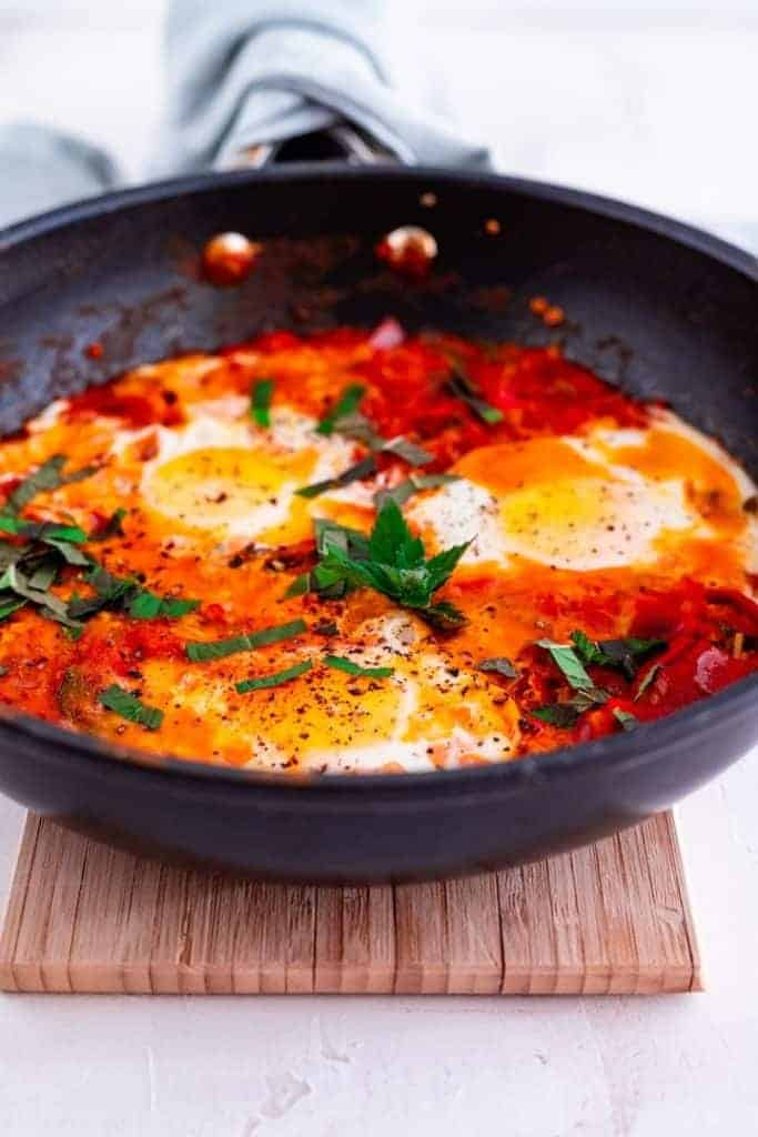 a skillet with freshly cooked shakshuka