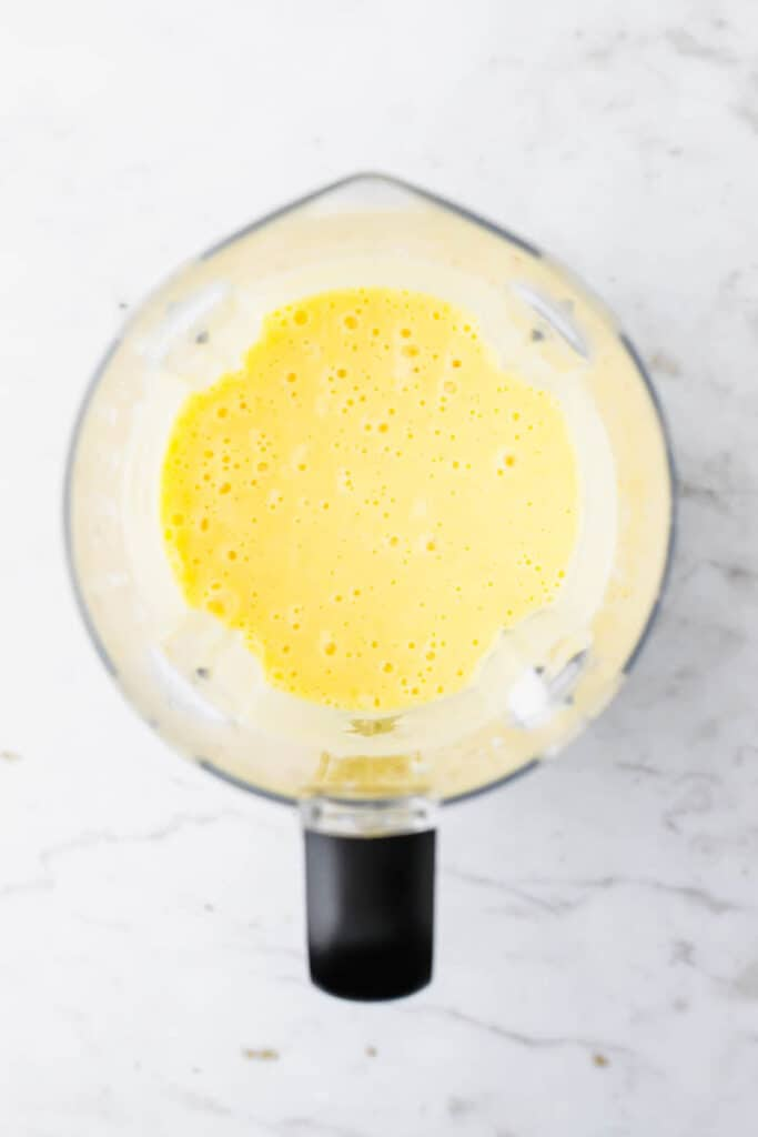 blended vegan mango lassi in a blender