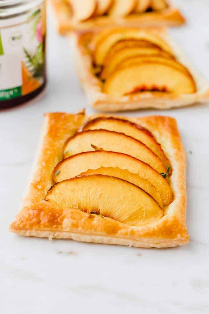 peach tarts on puff pastry