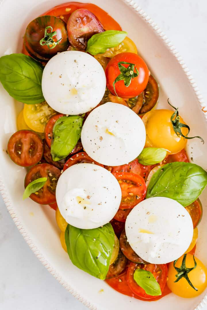 burrata caprese salad heirloom tomato burrata salad on a serving platter