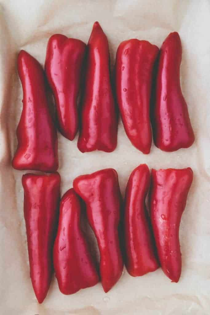 red peppers on a parchment paper ready to be roasted