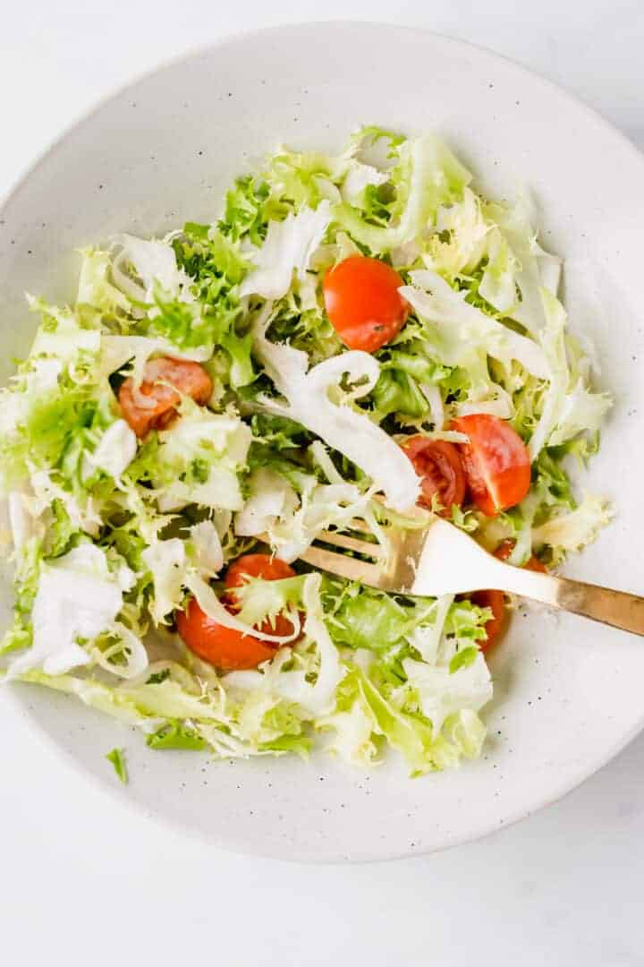 green salad with vegan salad dressing