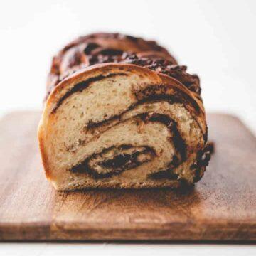 braided nutella bread on a dark wooden board