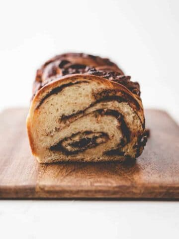 braided nutella bread on a dark wooden board
