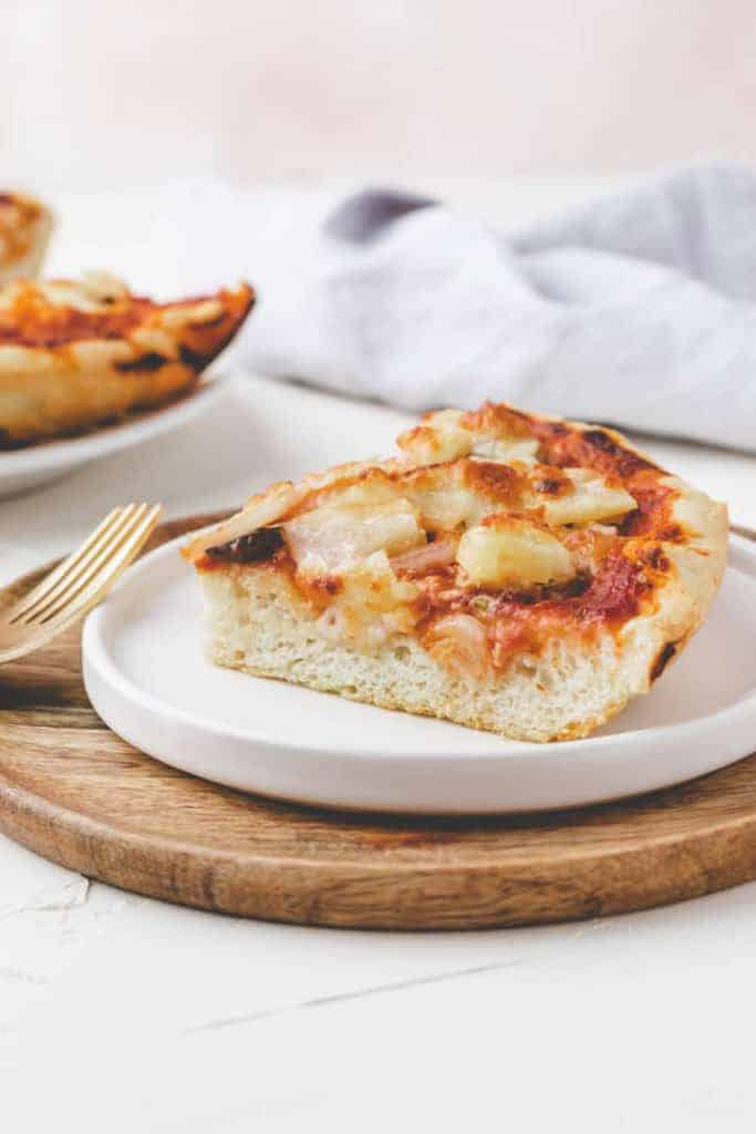 homemade pan pizza recipe served on a white plate
