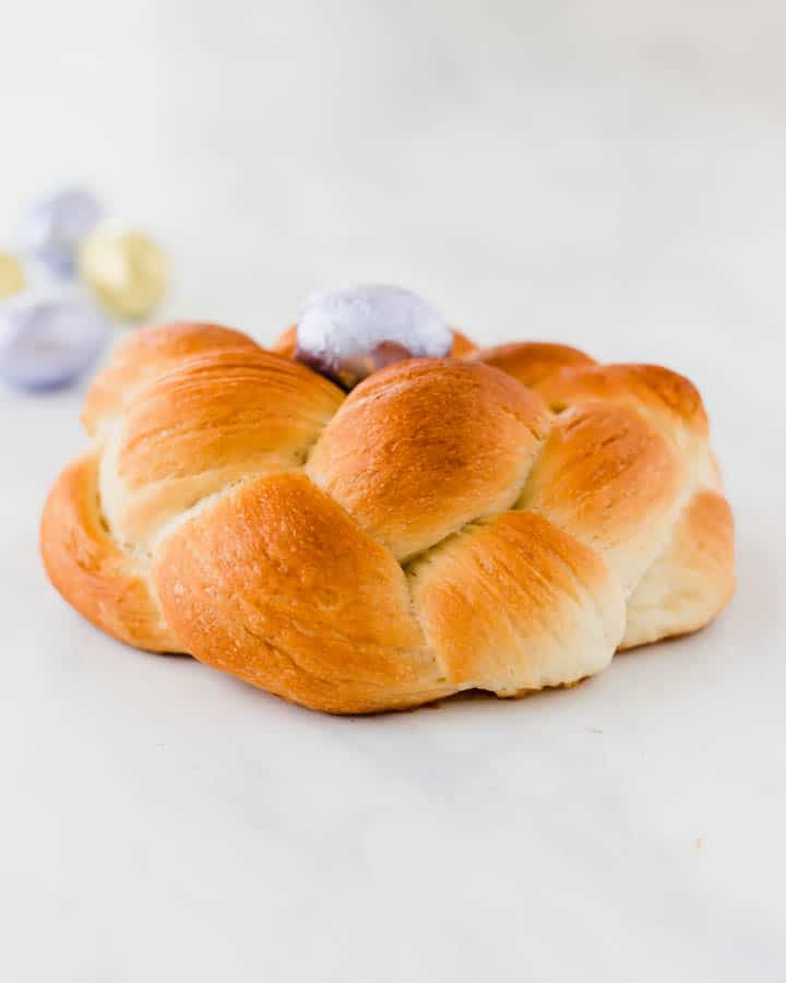 easter bread with three ropes and a easter chocolate egg in the middle