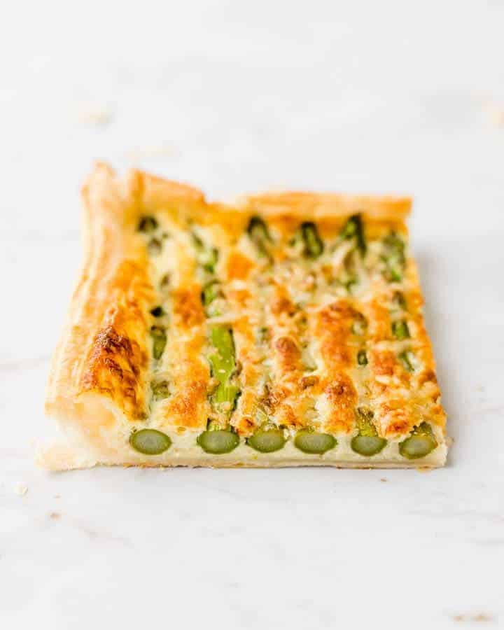 piece of baked asparagus tart puff pastry
