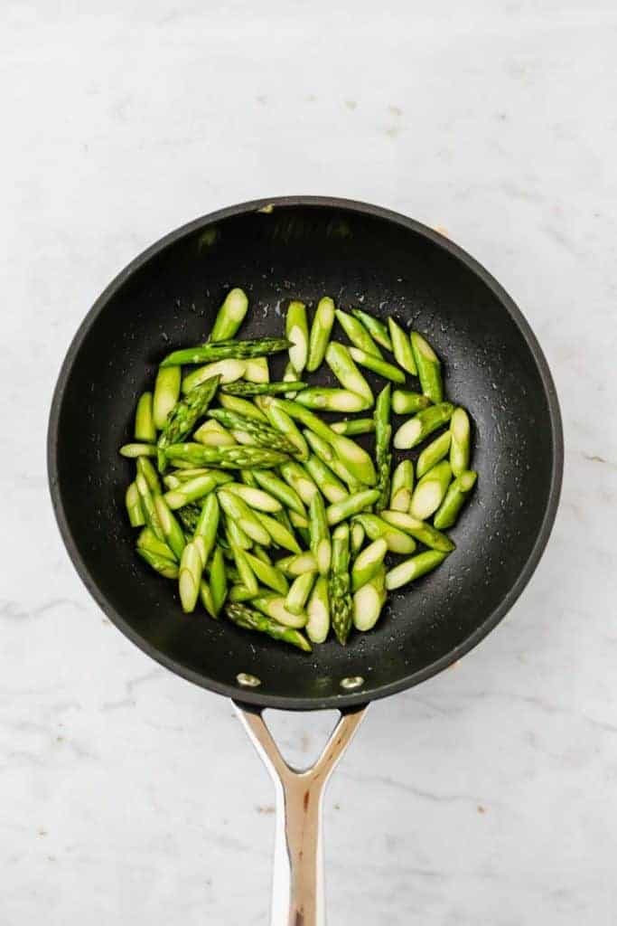 roasted green asparagus in a skillet