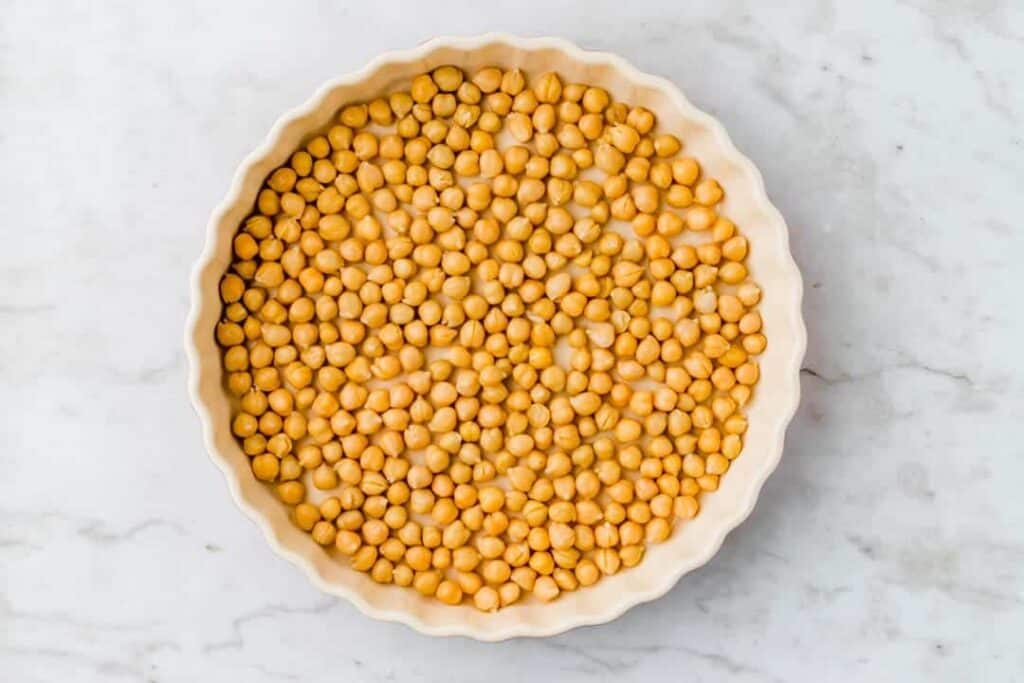 drained chickpeas in a baking dish