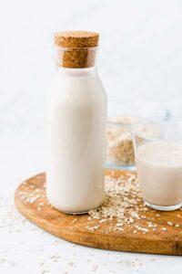 homemade oat milk in a glass bottle