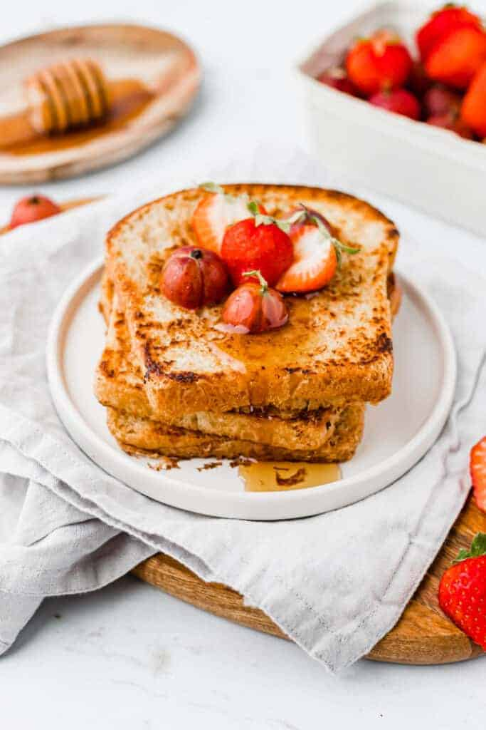 french toasts without egg served with berries and maple syrup