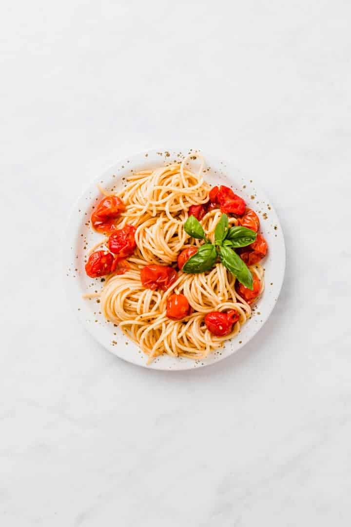 oven roasted cherry tomato pasta on a white plate