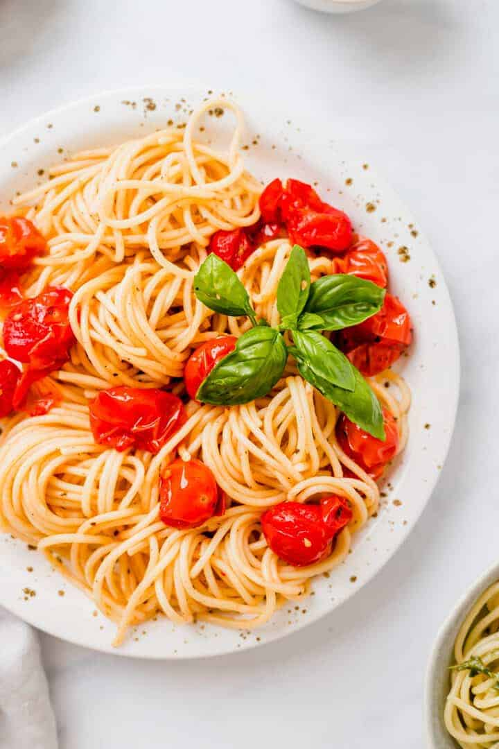 roasted cherry tomato pasta on a white plate