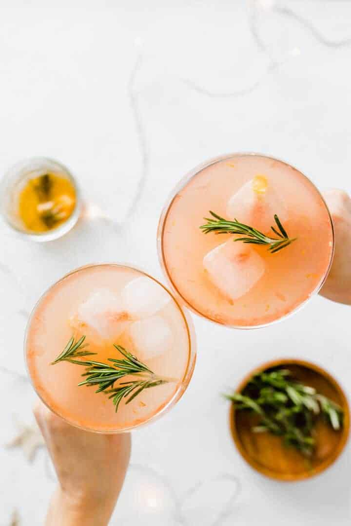 two glasses with grapefruit cocktail