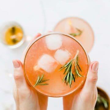grapefruit mocktail held between two hands