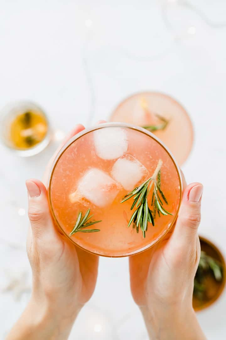 grapefruit mocktail held between two hands
