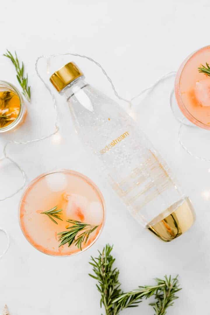 grapefruit christmas mocktail with a golden sodastream bottle
