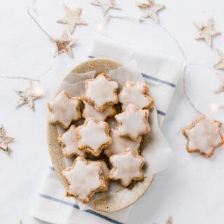 cinnamon cookies in star shape served on a brown plate