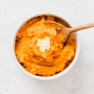 savory mashed sweet potatoes served with a piece of dairy-free margarine