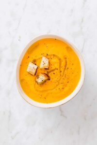 vegan carrot soup with orange and croutons