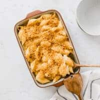 vegan baked mac and cheese in a blue baking dish