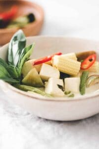 vegan thai green curry served in a bowl