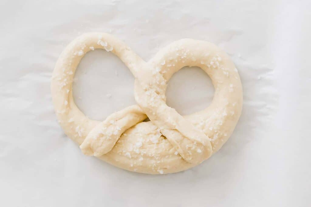 raw pretzel dough sprinkled with sea salt