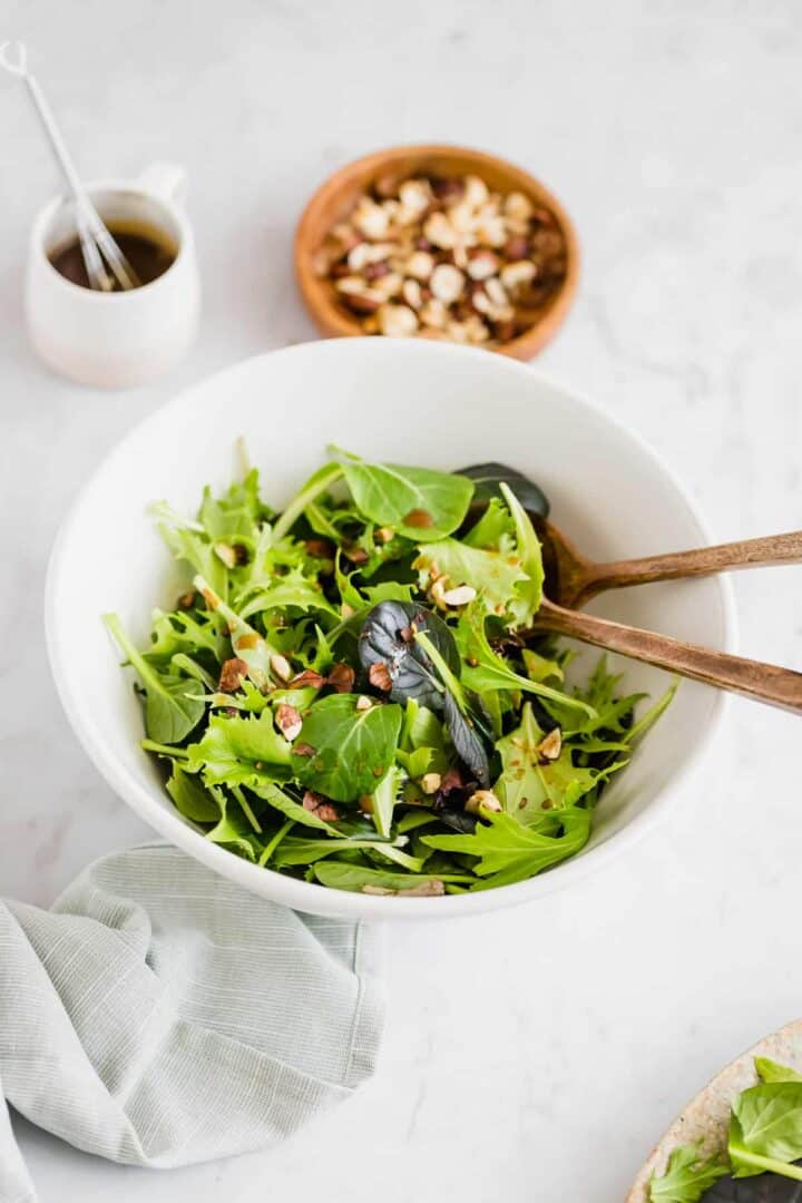 best green salad recipe served in a white bowl