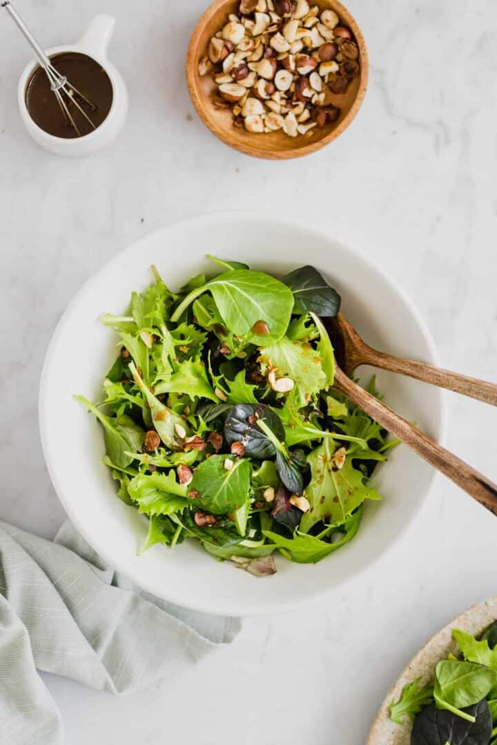 green salad served with toasted hazelnuts