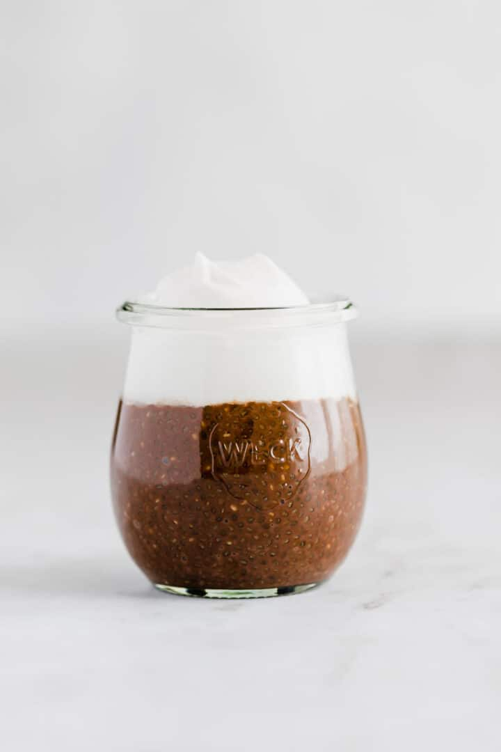 chocolate chia pudding with dairy-free whipped cream on top