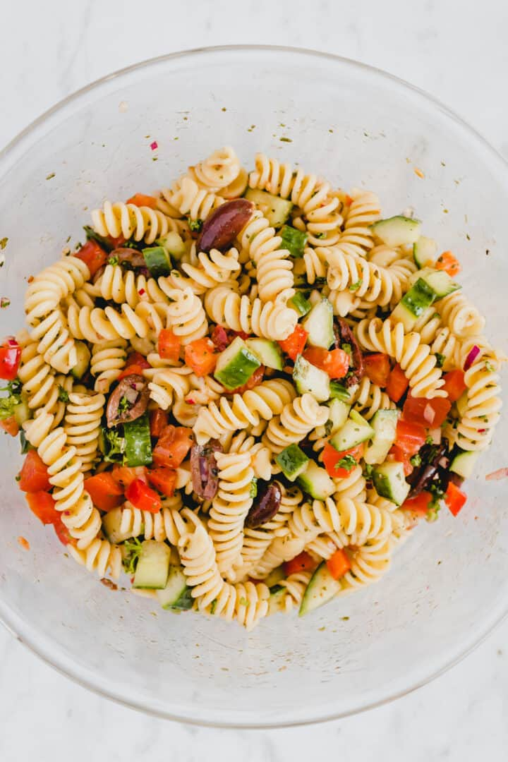 summer pasta salad in a glass bowl
