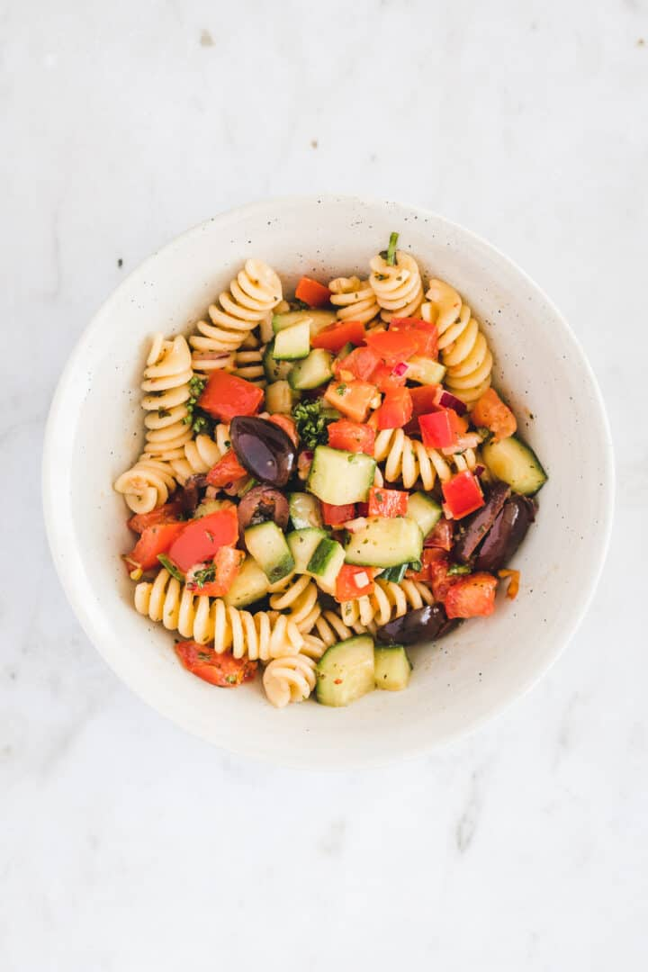 greek pasta salad in a small bowl