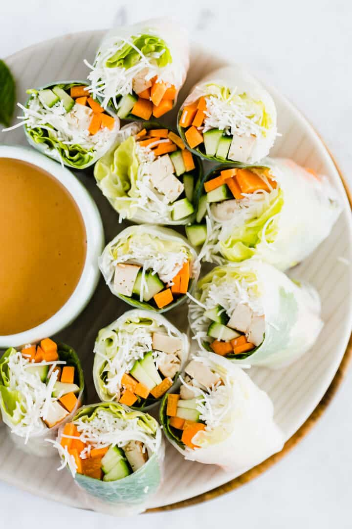 summer rolls with a bowl of peanut sauce for dipping