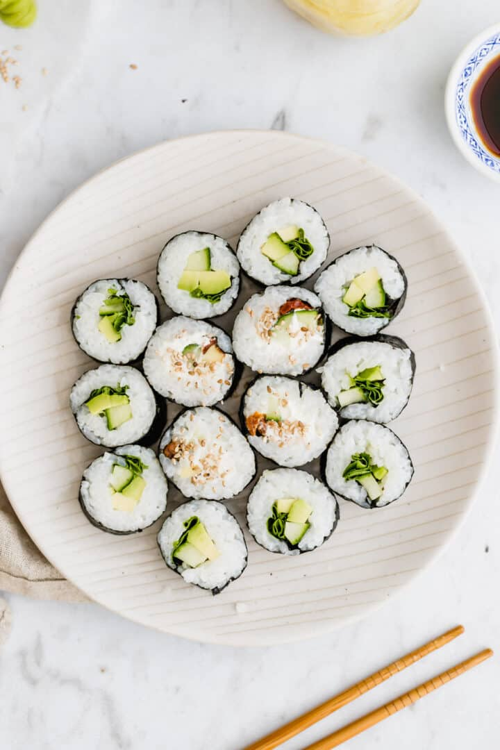 a plate with homemade vegan sushi